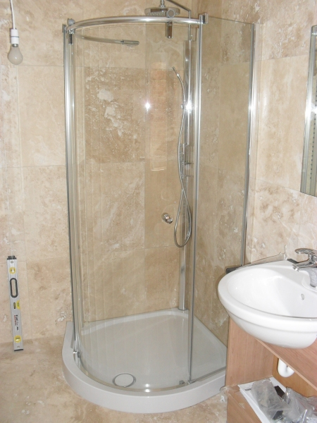 Bathroom fitters in Cirencester, floor to ceiling tiling, power showers installed, bathroom floor tiling Cirencesrer Glos